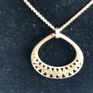 """The Sak gold color pendant with """"tribal design"""""""